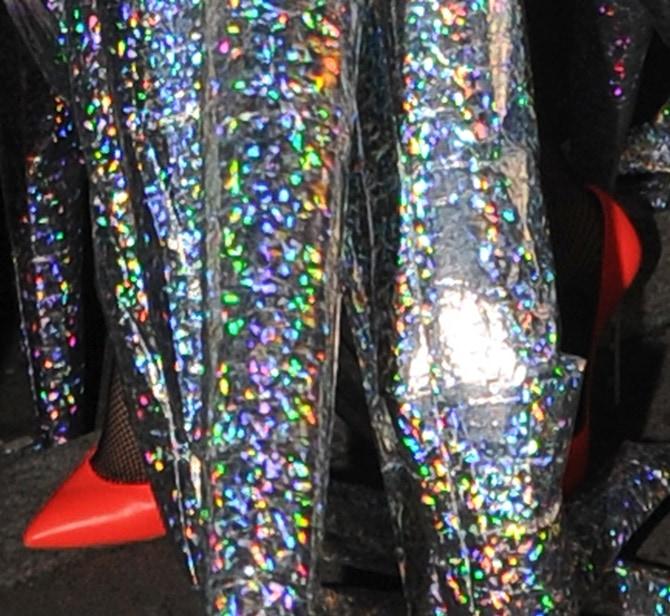 Lady Gaga wearing pointy-toe orange pumps