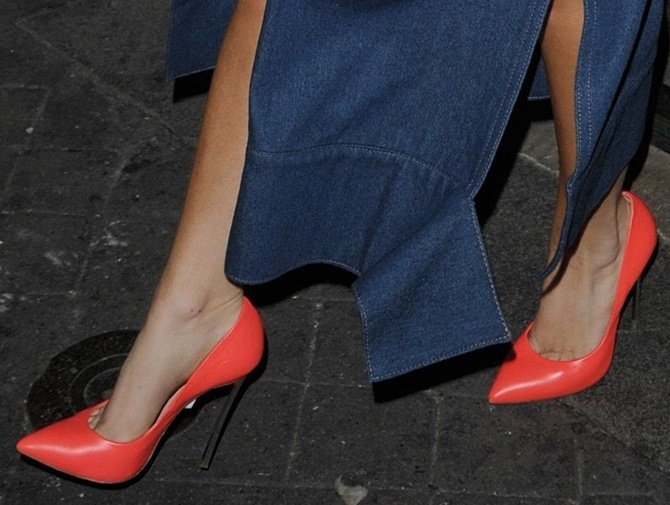 Lady Gaga decked in a large denim dress and bright orange pumps in Paris, France, on November 22, 2014