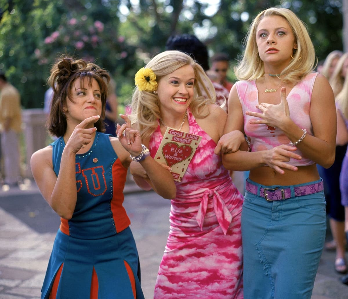 Reese Witherspoon as Elle Woods, Alanna Ubach as Serena McGuire, and Jessica Cauffiel as Margot in Legally Blonde