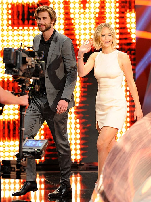 Liam Hemsworth and Jennifer Lawrence greeting the Wetten, dass..? audience