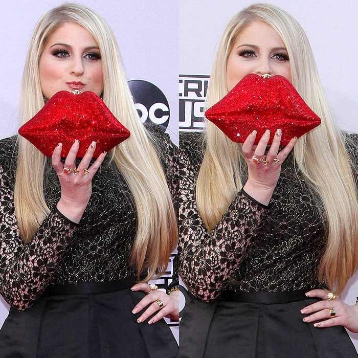Meghan Trainor posing with her red lips clutch at the 2014 American Music Awards