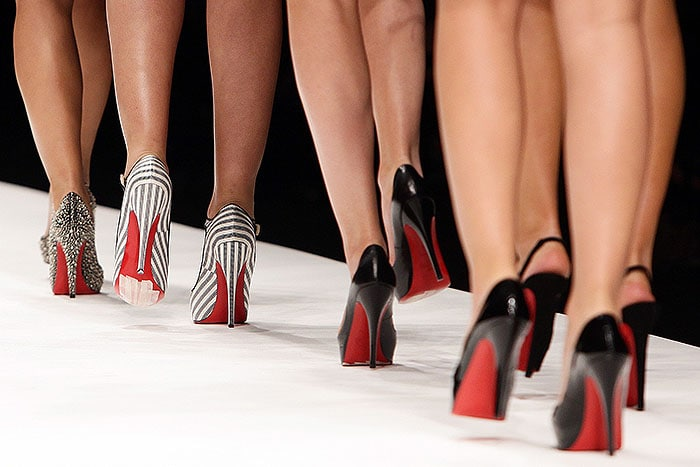 Models walking in Louboutins on the Fashion for Relief