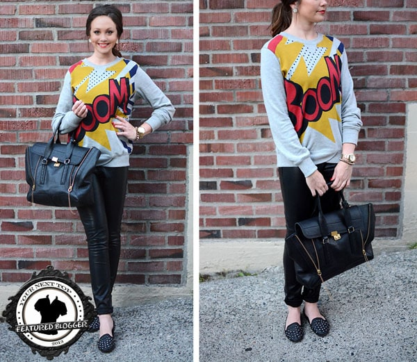 Nichole wears a Boom print sweater with panel leather pants