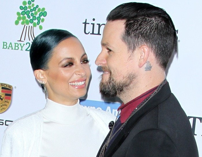 Nicole Richie, posing with husband Joel Madden, at the 2014 Baby2Baby Gala held at The Book Bindery in Culver City on November 8, 2014