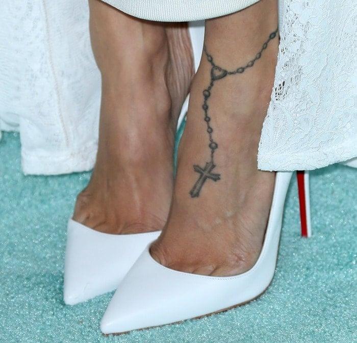 """Nicole Richie wearing white Christian Louboutin """"Iriza"""" pumps"""