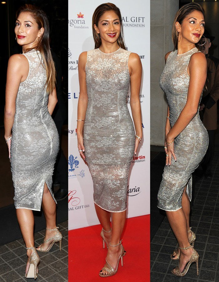 Nicole Scherzinger's dress features silver embellishments and a tight-fitting silhouette