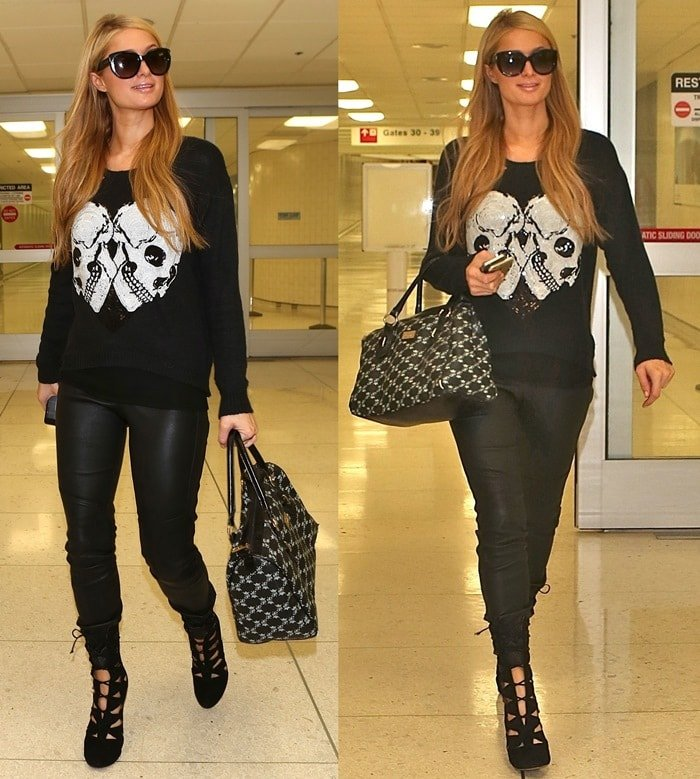 Paris Hilton wearing a black sweater with two skulls printed on the front