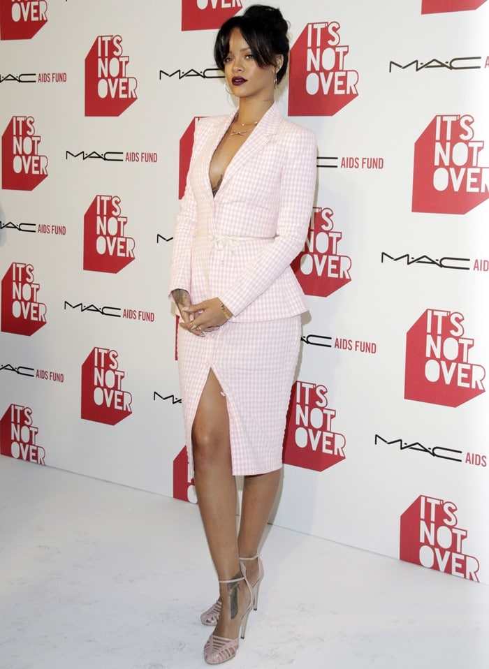 Braless Rihanna in a white-and-pink skirt suit from Altuzarra