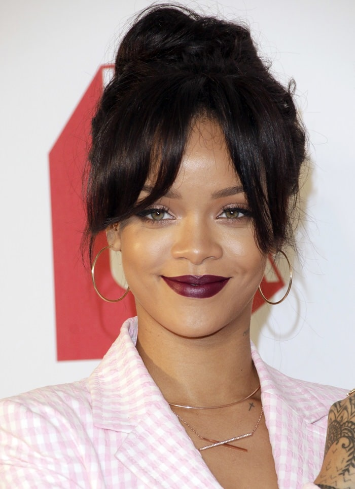Rihanna accessorized with a variety of jewelry