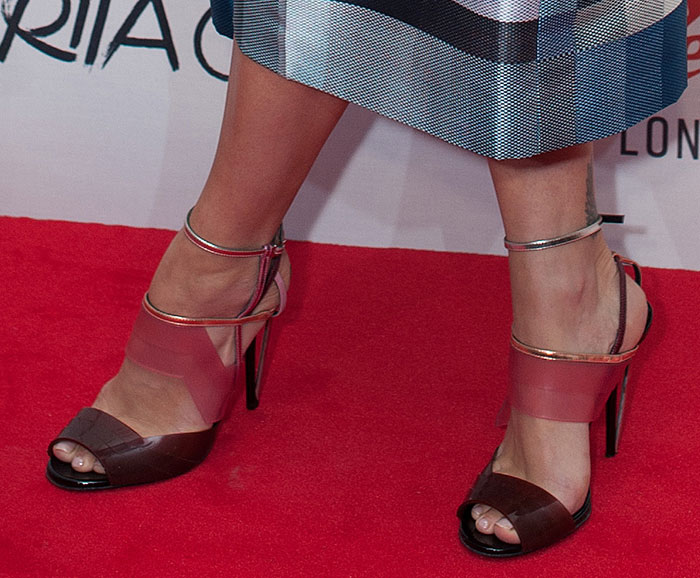 Rita Ora shows off her toes in Fendisandals