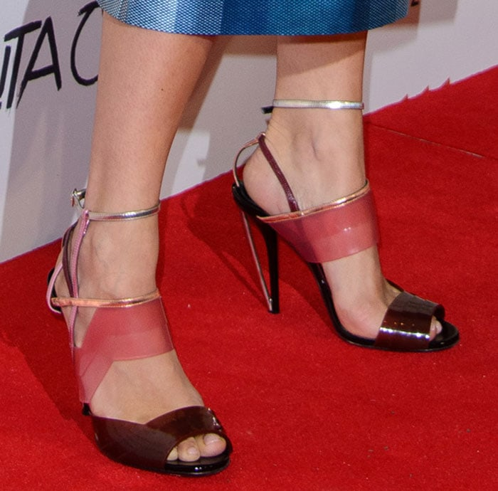 Rita Ora's modern Fendi sandals featuring PVC zigzag vamps and instep bands