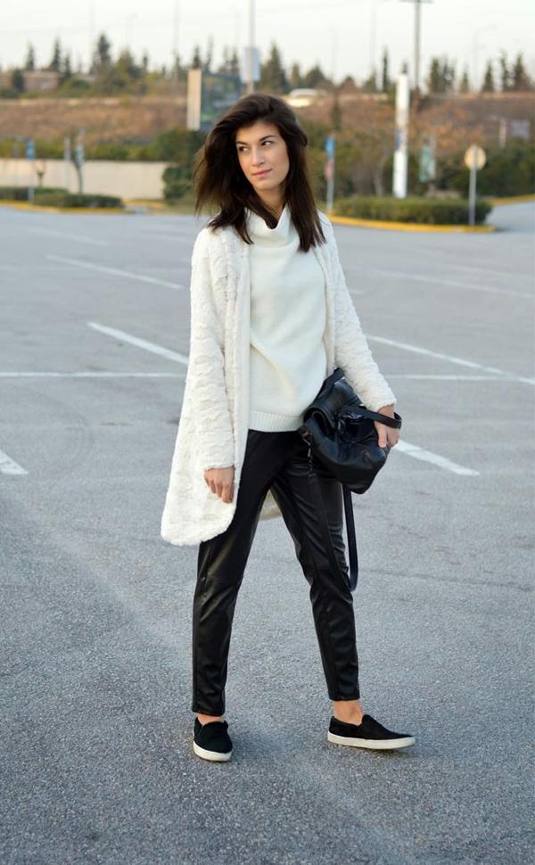 Savinadrocking her sweater with leather semi-loose pants