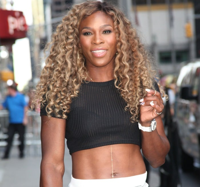 Serena Williams styled her sandals with a black midriff-baring top paired with a form-fitting white pencil skirt