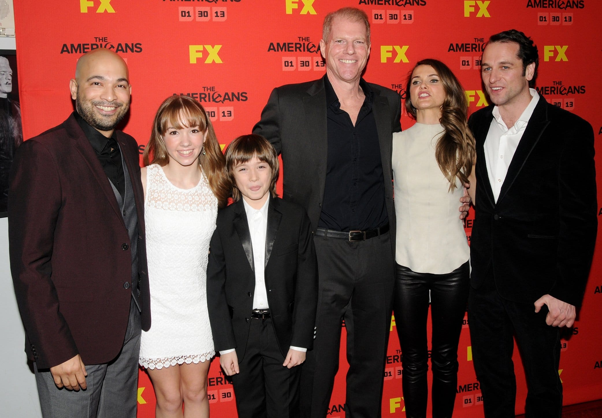 Maximiliano Hernández, Holly Taylor, Keidrich Sellati, Noah Emmerich, Keri Russell, and Matthew Rhys star in the American period spy thriller television series The Americans