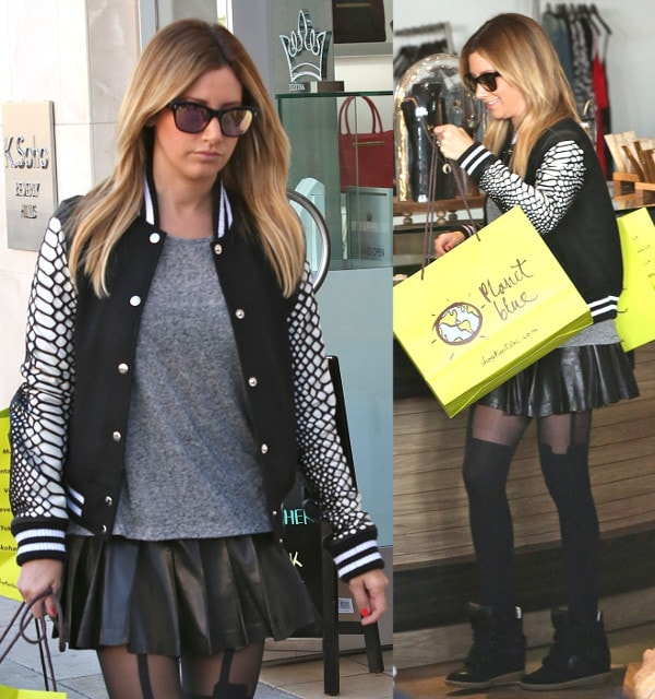 Ashley Tisdale looked edgy and chic in a black and white varsity jacket with croc-print sleeves