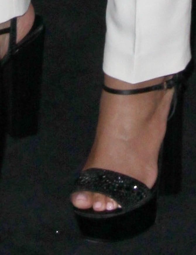 A closer look at Queen Bey's black glittery platform sandals