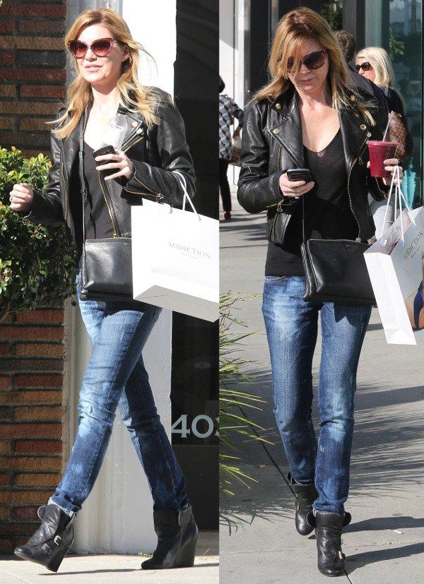 Ellen Pompeo wears a black leather jacket with blue jeans