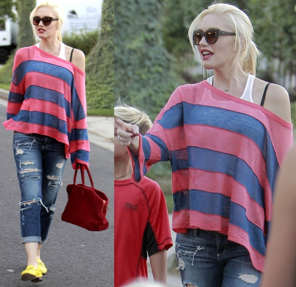 Gwen Stefani rocks a striped pink and blue shirt with destructed boyfriend jeans