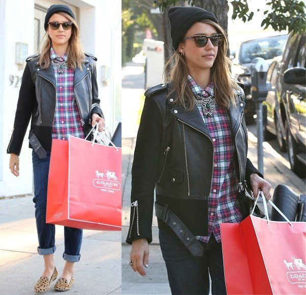 Jessica Alba wears a beanie with cheetah print flats and a leather jacket