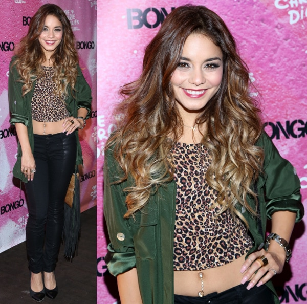 Vanessa Hudgens' dangling belly button ring in a cropped leopard-print top