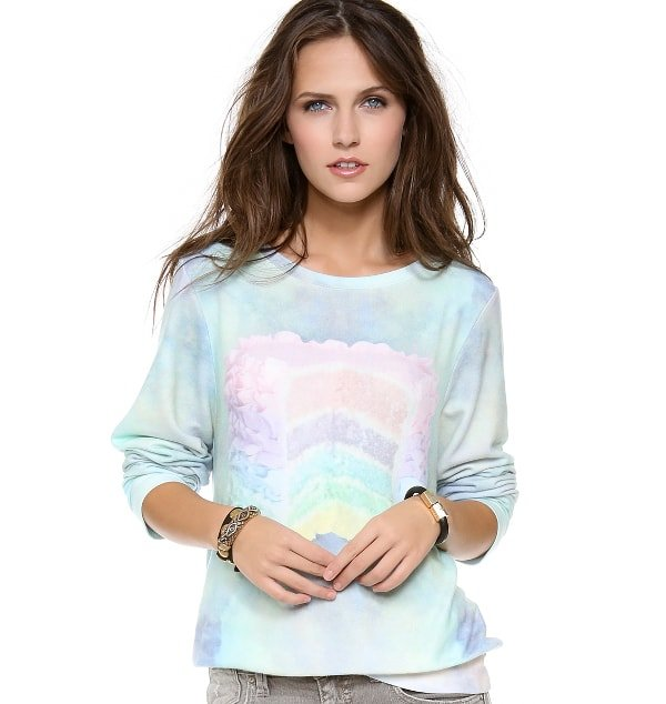 Rendered in a dreamy print, this ribbed sweatshirt is accented with a sweet cake graphic