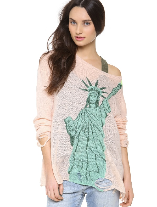 Lady Liberty lights up a relaxed loose knit sweater