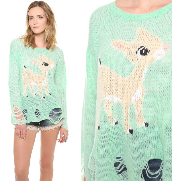 A doe-eyed baby deer animates this loose knit, mint green sweater