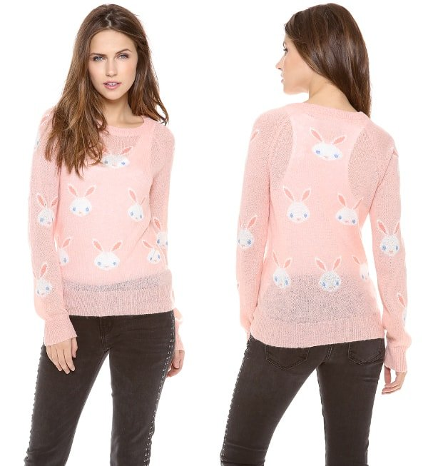 Snow bunnies on a rosy knit sweater