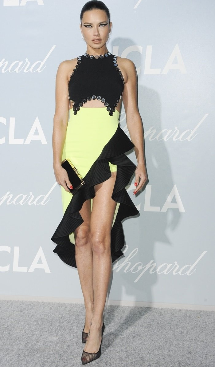 Adriana Lima flaunted her legs in a crepe de chine color block dress by David Koma