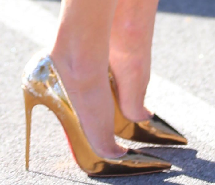 Alessandra Ambrosio wearing gold So Kate pumps