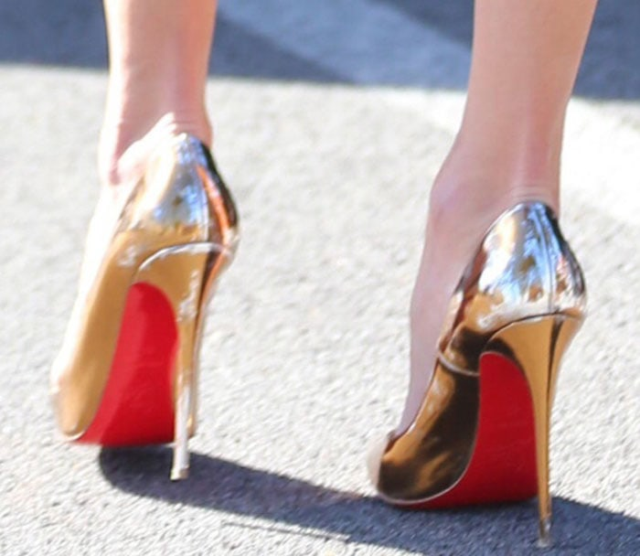 Alessandra Ambrosio shows off her red bottom shoes