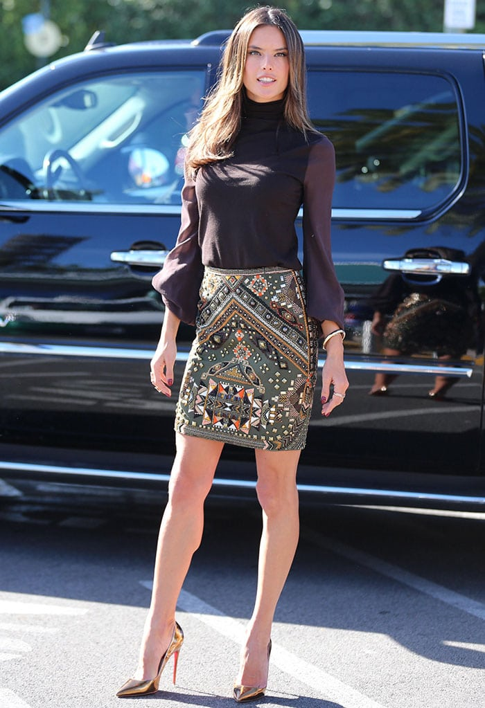 Alessandra Ambrosioin a brown turtleneck top paired with an intricately designed embellished skirt