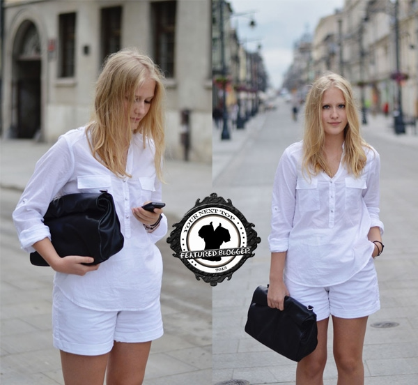 Alexandra wears an all-white outfit with a button-down shirt