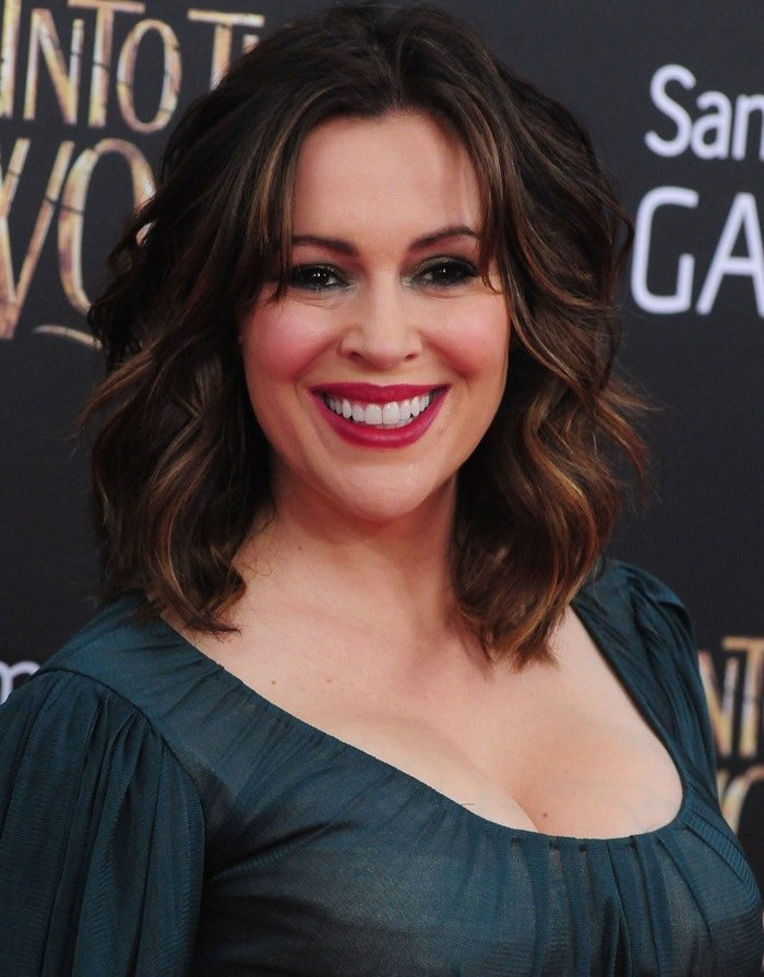 Alyssa Milano flaunting her curves at the premiere of Into the Woods in New York City on December 8, 2014