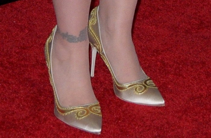 Alyssa Milano shows off her feet in satin pumps by Manolo Blahnik