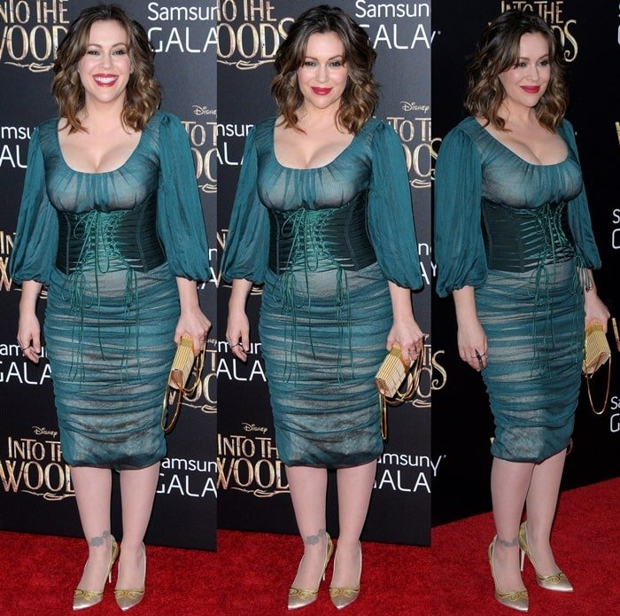 Alyssa Milano donned a dark green ruched chiffon dress from the Dolce & Gabbana Fall 2014 collection