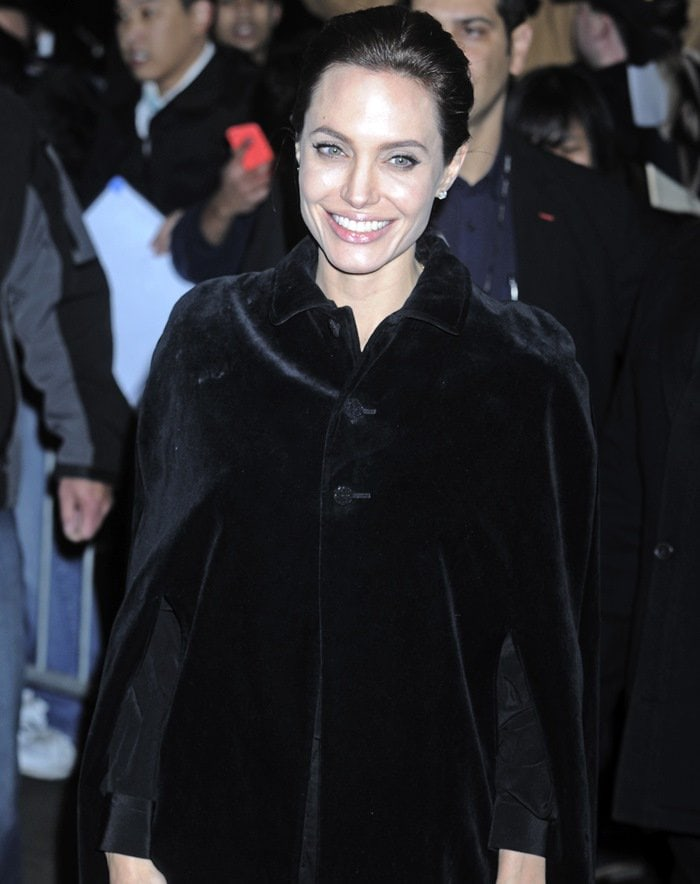 Angelina Jolie in a black cotton velvet cape from Saint Laurent featuring a classic collar