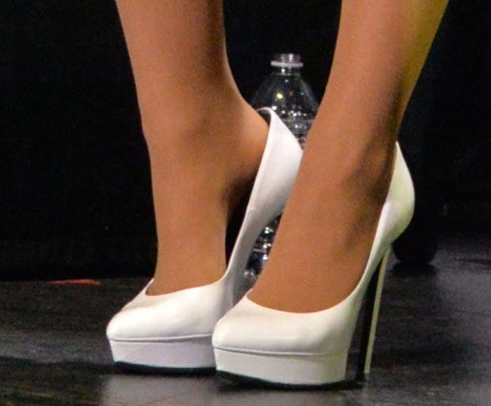 Ariana Grande shows off her white feet in Saint Laurent pumps