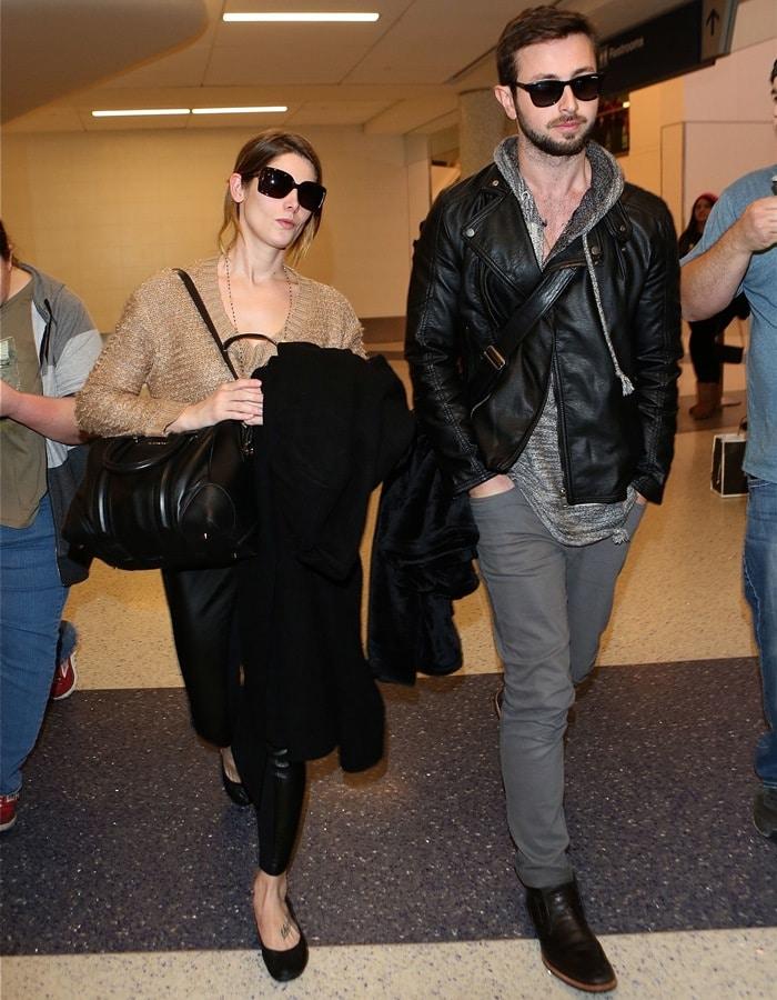 Ashley Greene infaux leather leggings by Ann Taylor andballet flats