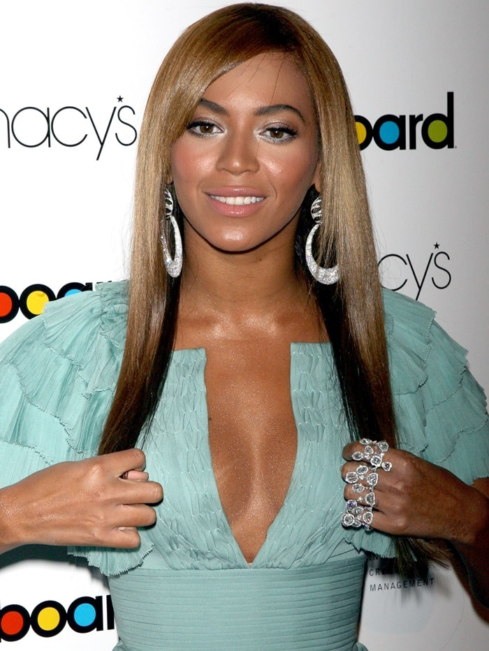 Beyonce turned heads in a Malandrino Resort 2010 dress featuring draped skirt and ruffled shoulders