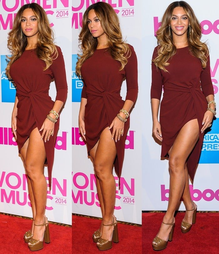 Beyonce flaunts her sexy legs in a merlot-colored knotted draped dress