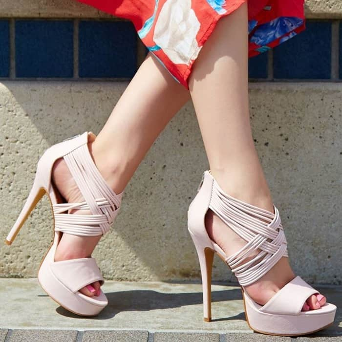 An abundance of crisscrossing straps at the ankle give bohemian flair to this sandal