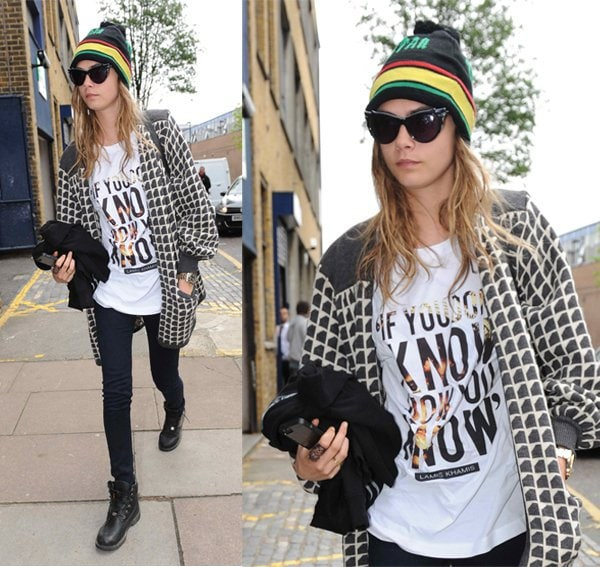 Cara Delevingne in London casually dressed in a beanie hat and a trendy Lamis Khamis T-shirt