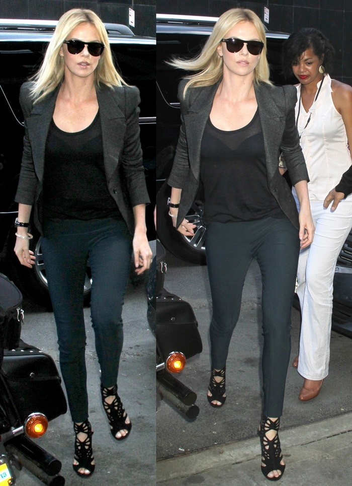 Charlize Theron paired her black cage sandals with a slim blazer and skinny jeans