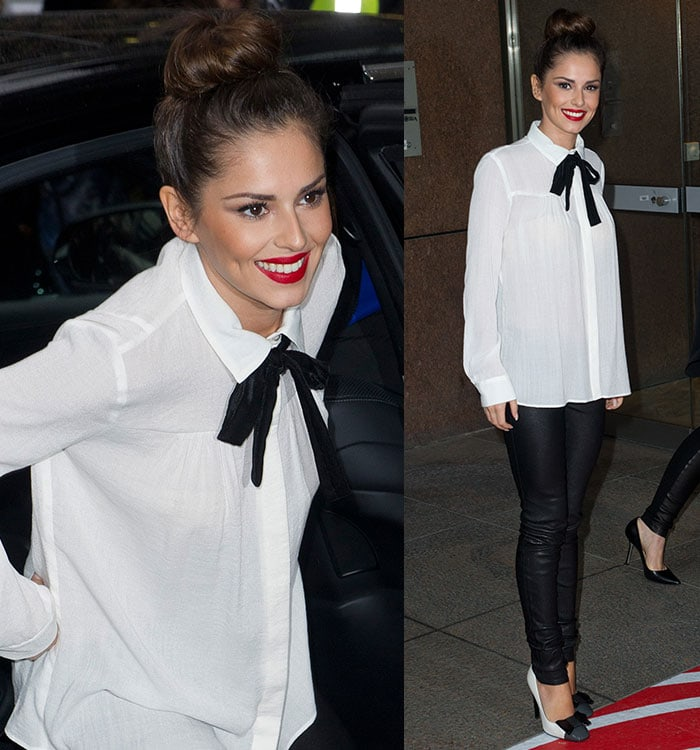 Cheryl Fernandez-Versini wearing a white Maje long-sleeved blouse and a black pussy bow tie with black Helmut Lang leather pants