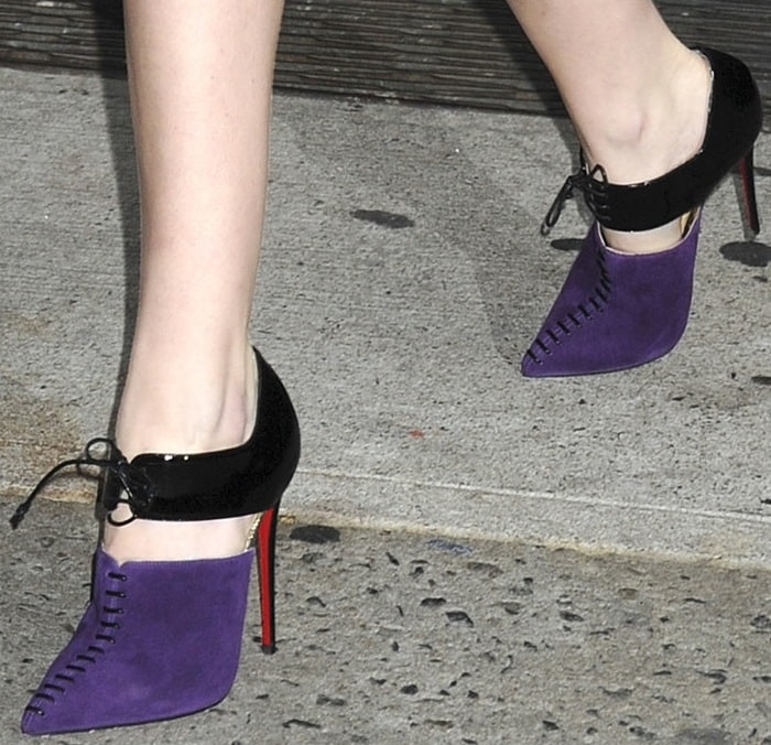 Anna Kendrick shows off her feet inCorsita ankle boots in black and purple