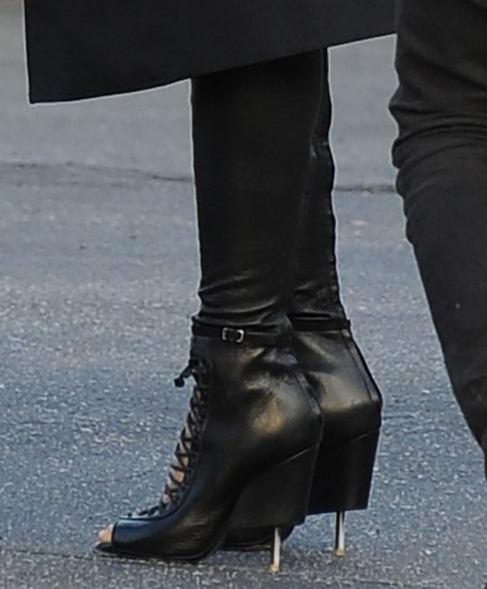 Ciara in Givenchythigh-high lace-up boots for a Vogue photoshoot