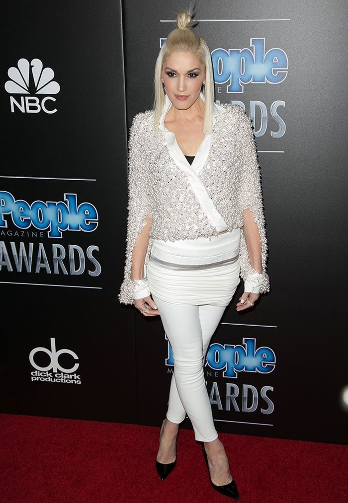 Gwen Stefani wears apearl-bead-embellished with a miniskirt and leather pants