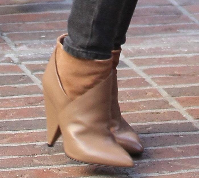 Hilary Duff'sboots featurewide cone heels