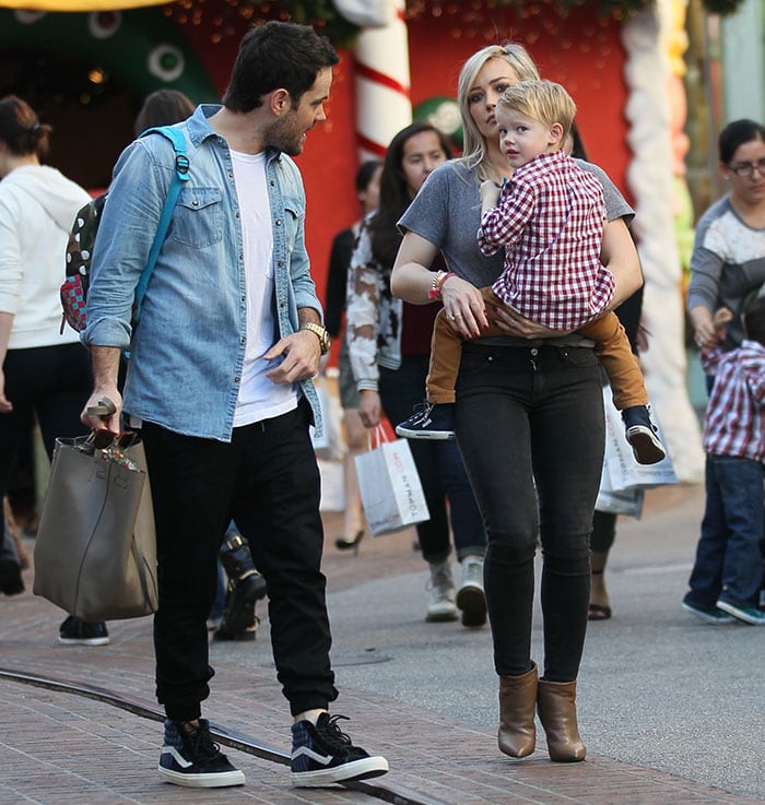 Hilary Duff, Mike Comrie, and their son, Luca, at The Grove in Los Angeles on December 23, 2014